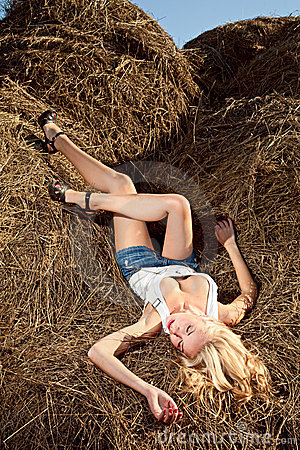Beauty woman in hay