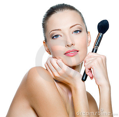 Beauty woman  holds make-up brushes
