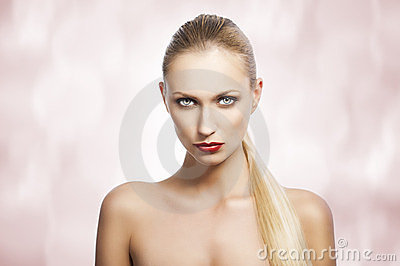Beauty woman over white. She looks in to the lens