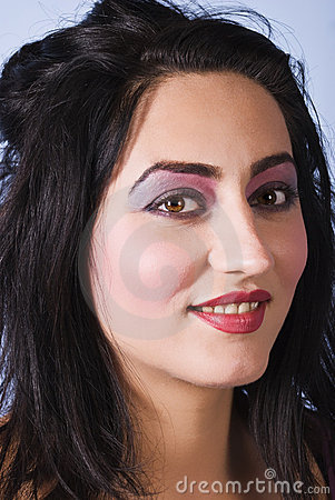 Beauty woman with pink-mauve make up