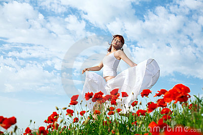 Beauty woman in poppy field