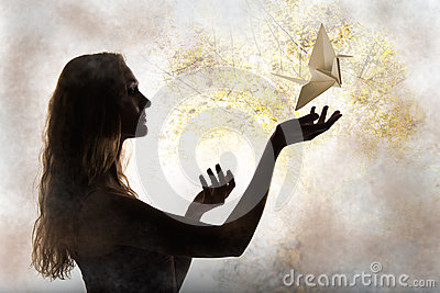 Beauty woman silhouette with flying paper crane