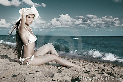 Beauty woman sit on sea