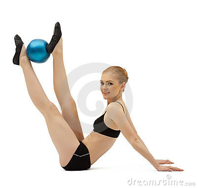 Beauty woman training with gymnastic ball