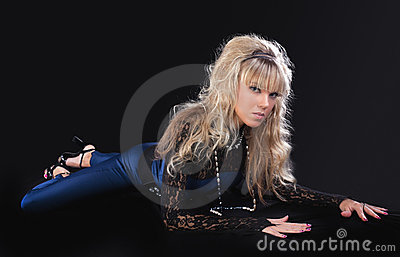 Beauty young blond girl lay on ground