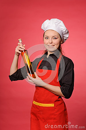 Beauty young cook hold bottle