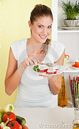 Beauty, young girl eating mozzarella salad