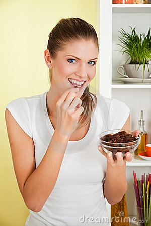 Beauty, young girl eating raisin