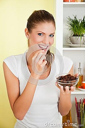 Beauty, young girl eating raisin