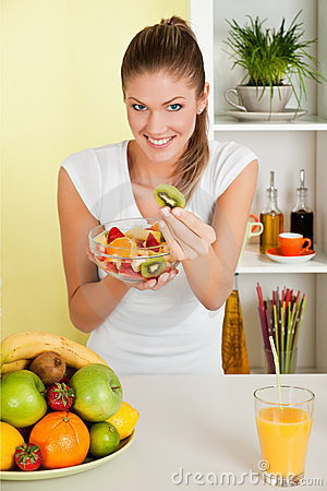 Beauty, young girl holding fruit salad