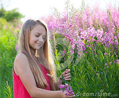 Beauty young girl on meadow