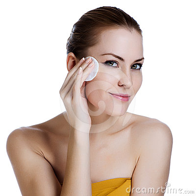 Beauty young woman applying face foundation