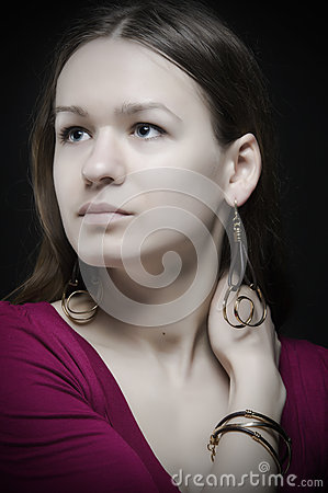 Beauty young woman with earrings looking away