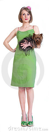 Beauty young woman in green dress with dog