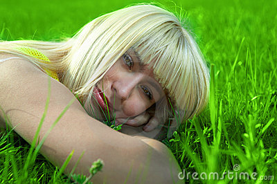 Beauty young woman jump in field