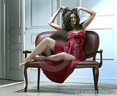 Beauty young woman on sofa