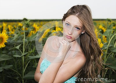 Beauty young woman in sunflower field