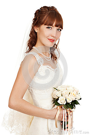 A beautyful bride holding her bouquet from roses and smiling.  I