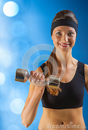 A beautyful sporty girl with dumbbell