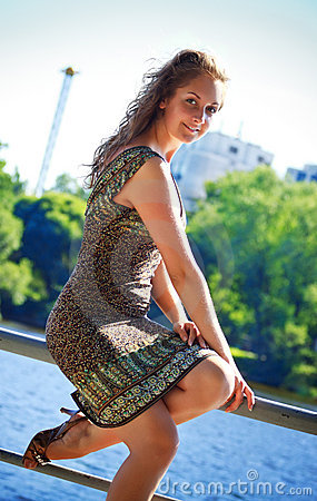 Beautyful woman sitting on parapet
