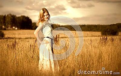 Beautyful woman in summer field