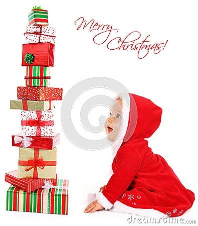 Bebé de la Navidad con los regalos