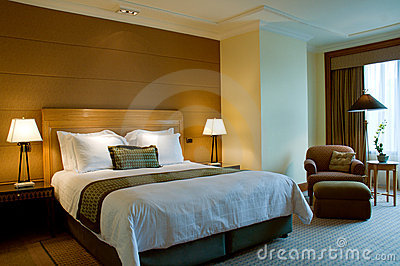 Bed and armchair in a 5 star suite bedroom