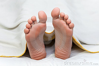 Bed blanket on human foot