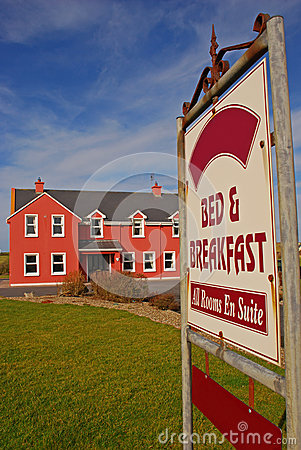 Bed and Breakfast Signboard and Beautiful Building Stock Photo