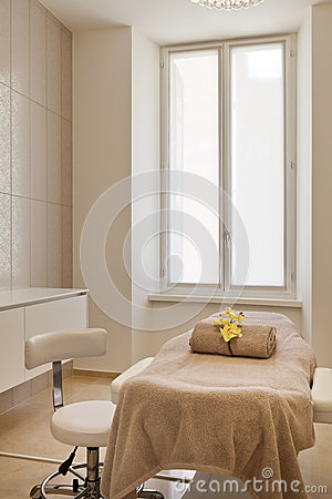 Bed and chair of the spa salon