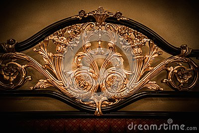 Bed with golden ornament