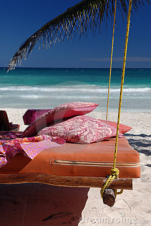 Bed on tropical beach