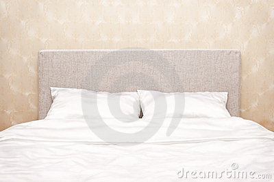 Bed at a wall