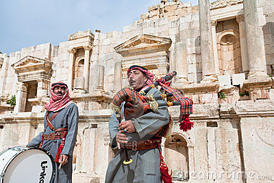 Bedouin plays on bagpipes in Jerash Editorial Stock Photo