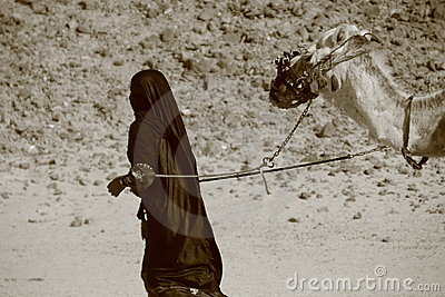 Bedouin woman with camel