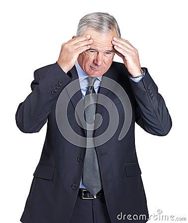 Bedrijfs mens in depressie met hand op voorhoofd