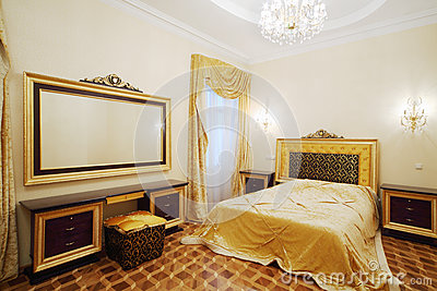 Bedroom with beautiful bed, bedside tables and big mirror