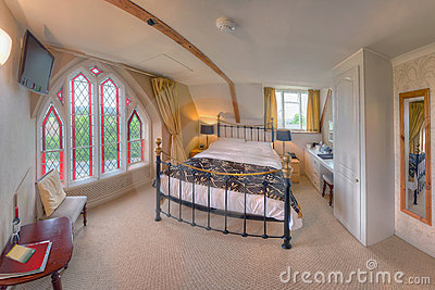 Bedroom with stained-glass window (The Belfry)
