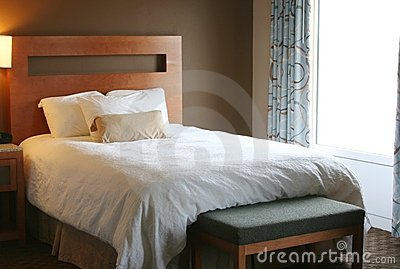 Bedroom with white blanket on bed