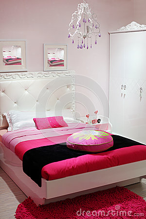 Bedroom with white wardrobe and pink carpet.