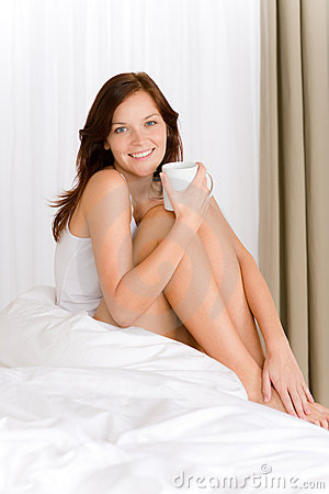 Bedroom - young woman drink coffee