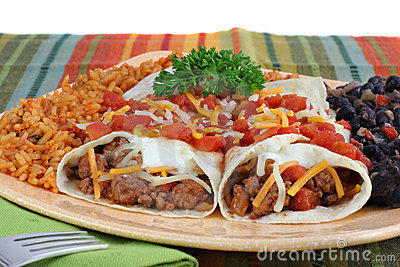 Beef Burrito Dinner with rice and black beans.