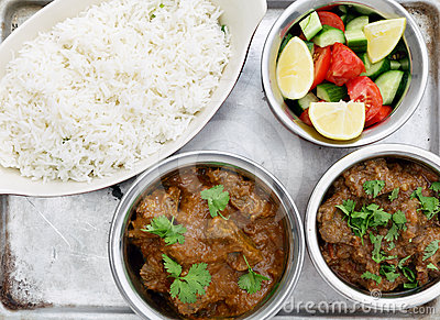 Beef curries with salad and rice