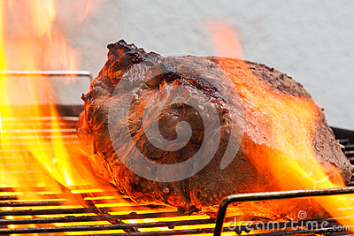 Beef in flames on grill
