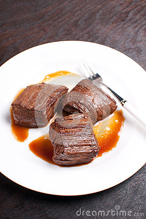 Beef flank steak pieces marinated and cooked
