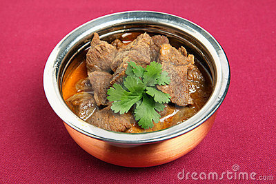 Beef korma and coriander