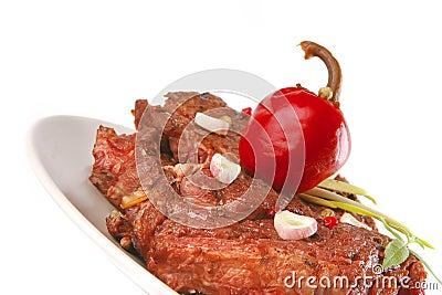 Beef meat chunk on grey dish