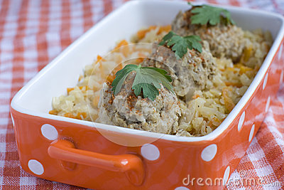 Beef meatballs with braised cabbage and carrot