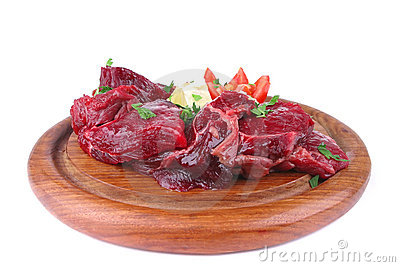 Beef ribs on wooden plate