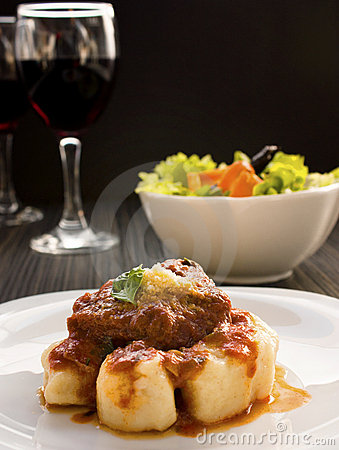 Beef with sauce and gnocchi